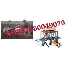 Mesin Penanam Jagung dan Pupuk Dengan Hand Traktor