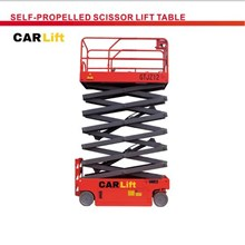 Self propelled scissor lift table